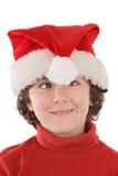 Muchacho divertido con el sombrero rojo de la Navidad Imagen de archivo libre de regalías