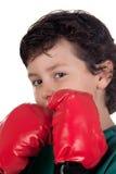 Muchacho divertido con los guantes de boxeo Imagen de archivo libre de regalías