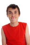 Muchacho divertido de la cara con el caramelo de los dientes de dracula Fotografía de archivo libre de regalías