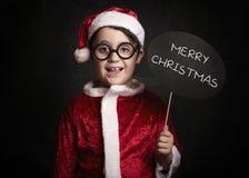 Muchacho divertido en la Navidad imagen de archivo