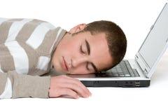 Muchacho durmiente de la computadora portátil Fotografía de archivo libre de regalías