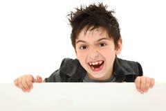 Muchacho emocionado loco que lleva a cabo la lona en blanco imagenes de archivo