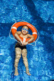 Muchacho en anillo inflable Foto de archivo libre de regalías