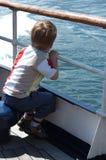 Muchacho en barco Imagen de archivo libre de regalías