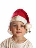 Muchacho en casquillo de la Navidad Imagenes de archivo