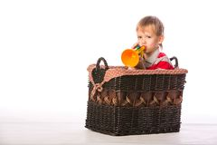 Muchacho en cesta con el juguete Imagenes de archivo