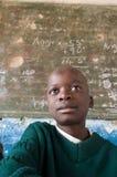 Muchacho en clase en Zimbabwe Imagen de archivo libre de regalías