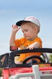 Muchacho en coche del juguete Fotografía de archivo