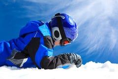 Muchacho en desgaste del esquí Fotografía de archivo