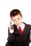 Muchacho en dresscode oficial con un teléfono celular Foto de archivo libre de regalías