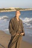 Muchacho en el abrigo de Brown Fotografía de archivo libre de regalías
