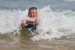 Muchacho en el mar Imagen de archivo