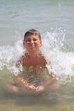 Muchacho en el mar Imagenes de archivo