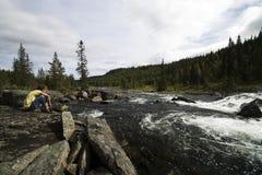 Muchacho en el río de la montaña Imagen de archivo libre de regalías