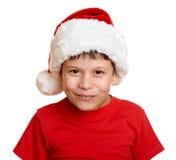 Muchacho en el retrato del sombrero del ayudante de santa - concepto de la Navidad de las vacaciones de invierno Foto de archivo libre de regalías