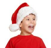 Muchacho en el retrato del sombrero del ayudante de santa - concepto de la Navidad de las vacaciones de invierno Imagenes de archivo