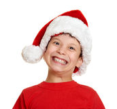 Muchacho en el retrato del sombrero del ayudante de santa - concepto de la Navidad de las vacaciones de invierno Fotografía de archivo