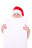 Muchacho en el sombrero de la Navidad con un espacio en blanco Fotos de archivo