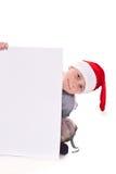 Muchacho en el sombrero de la Navidad con un espacio en blanco Imagenes de archivo