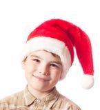 Muchacho en el sombrero de Papá Noel Imagen de archivo libre de regalías