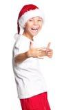 Muchacho en el sombrero de Papá Noel Fotos de archivo libres de regalías