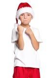 Muchacho en el sombrero de Papá Noel Fotos de archivo