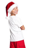Muchacho en el sombrero de Papá Noel Fotografía de archivo libre de regalías