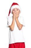 Muchacho en el sombrero de Papá Noel Foto de archivo libre de regalías