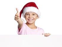 Muchacho en el sombrero de Santa Foto de archivo