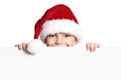 Muchacho en el sombrero de Santa Imagenes de archivo
