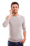 Muchacho en el teléfono Foto de archivo libre de regalías