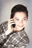 Muchacho en el teléfono móvil Fotografía de archivo