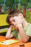 Muchacho en jardín de la infancia Foto de archivo libre de regalías