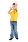 Muchacho en la camiseta amarilla aislada Foto de archivo libre de regalías