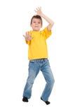 Muchacho en la camiseta amarilla aislada Fotografía de archivo