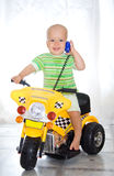 Muchacho en la motocicleta Foto de archivo libre de regalías