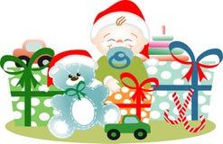 Muchacho en la Navidad con todo sus regalos Foto de archivo