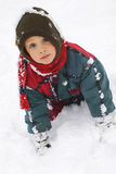Muchacho en la nieve Foto de archivo libre de regalías