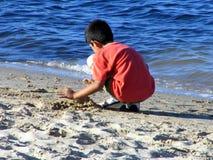 Muchacho en la playa Foto de archivo libre de regalías