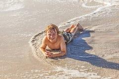 Muchacho en la playa Imagen de archivo libre de regalías