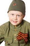 Muchacho en la ropa del soldado Imagen de archivo