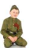Muchacho en la ropa del soldado Foto de archivo libre de regalías