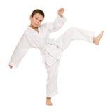 Muchacho en la ropa para los artes marciales Imagen de archivo libre de regalías