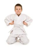 Muchacho en la ropa para los artes marciales Imágenes de archivo libres de regalías