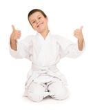 Muchacho en la ropa para los artes marciales Foto de archivo