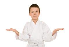Muchacho en la ropa para los artes marciales Fotografía de archivo libre de regalías