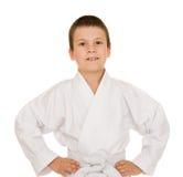 Muchacho en la ropa para los artes marciales Fotografía de archivo
