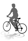 Muchacho en la silueta de la bici Imagen de archivo