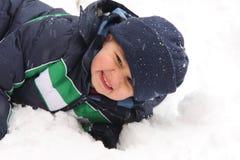Muchacho en nieve Imagen de archivo libre de regalías