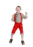 Muchacho en pantalones rojos Fotos de archivo libres de regalías